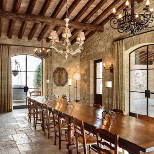 Example of a large tuscan limestone floor and beige floor great room design in Orange County with beige walls