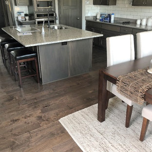 Kitchen/dining room combo - mid-sized craftsman medium tone wood floor and brown floor kitchen/dining room combo idea in Minneapolis with beige walls