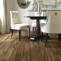 """Shaw Madagascar Tile - Shaw's Madagascar Saddle in 6"""" x 24"""" size  is a porcelain tile that resembles exotic hardwood. The realistic look comes from HD Inkjet technology and installed in a staggered pattern."""