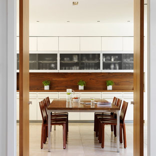 Inspiration for a contemporary dining room in London with limestone flooring.