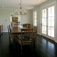 Traditional Dining Room by Stone Creek Construction