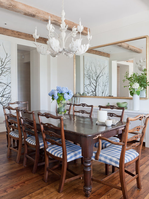 coastal dining room photo in new york with white walls and dark hardwood floors. beautiful ideas. Home Design Ideas
