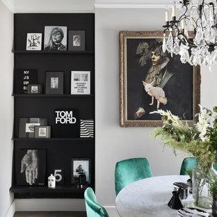 Photo of a medium sized bohemian open plan dining room in London with grey walls, medium hardwood flooring and grey floors.