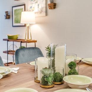 Immagine di una sala da pranzo aperta verso il soggiorno tradizionale di medie dimensioni con pareti grigie, pavimento in laminato, nessun camino e pavimento grigio