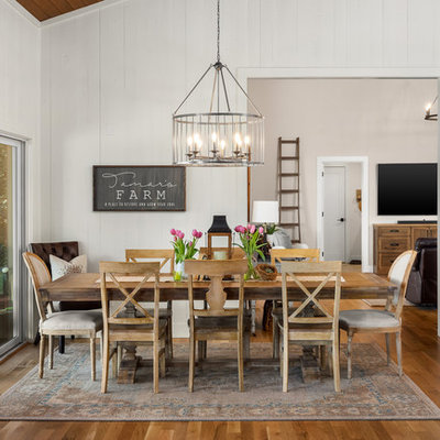Inspiration for a country medium tone wood floor and brown floor dining room remodel in Portland with white walls