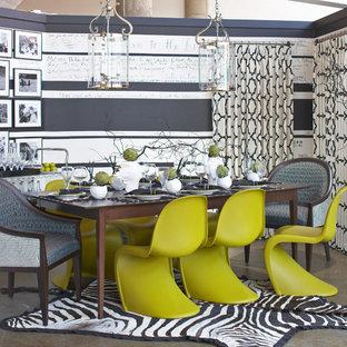 Idée de décoration pour une salle à manger bohème avec béton au sol.