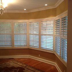 "Shutters on a Dining Room Window - We installed these beauties in a customers dining room window.  The value-priced White Hunter Douglas NewStyle®​ 3 1/2"" Hybrid Shutters blend the beauty of real wood and advanced modern-day materials to create a stunning and durable window covering for any room."