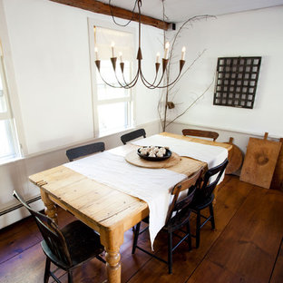 Inspiration for a farmhouse dark wood floor dining room remodel in Boston with white walls