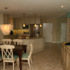 Beach Style Dining Room by Yoder Homes