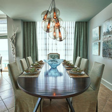 Beach Style Dining Room by Lovelace Interiors