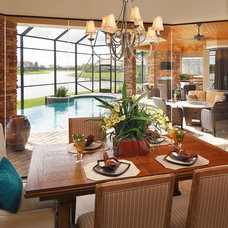 Tropical Dining Room by Christopher Burton Homes, Inc.