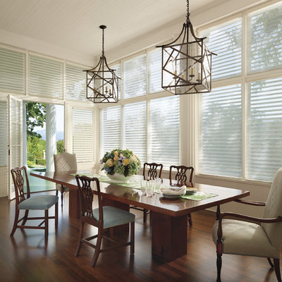 Inspiration for a large transitional dark wood floor and brown floor great room remodel in New York with beige walls and no fireplace
