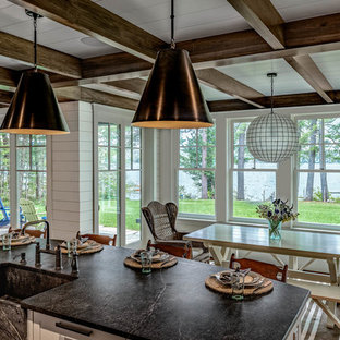 Example of a beach style dining room design in Boston