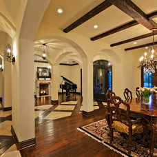 Mediterranean Dining Room by Hendricks Construction