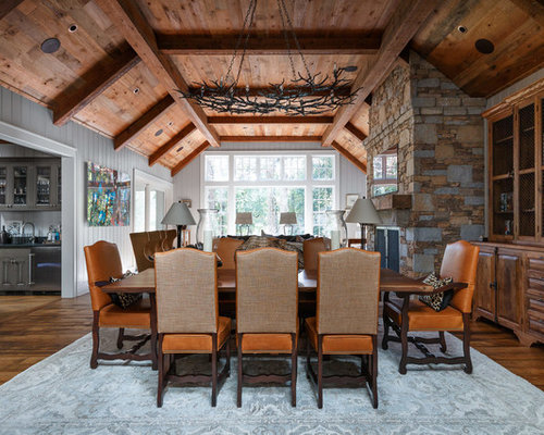 rustic dark wood floor dining room idea in other with gray walls a standard fireplace - Rustic Dining Room Table Decor