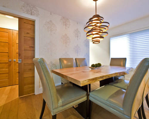 Trendy Dining Room Photo In Calgary With White Walls And Medium Tone Wood Floors
