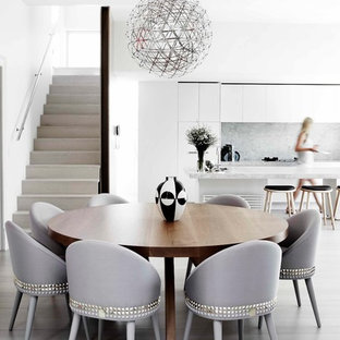 Example of a trendy kitchen/dining room combo design in Melbourne with white walls