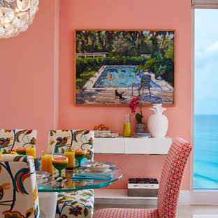 Design ideas for a world-inspired dining room in Miami with pink walls.