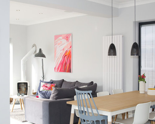 Inspiration for a scandinavian dining room remodel in other with white walls