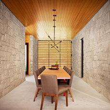 Midcentury Dining Room by Stuart Sampley Architect