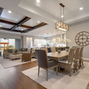 Example of a transitional medium tone wood floor and brown floor great room design in Jacksonville with gray walls