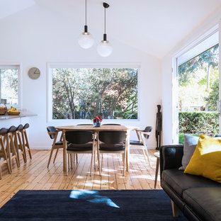 Photo of a small contemporary dining room in Canberra - Queanbeyan with white walls, medium hardwood floors and brown floor.