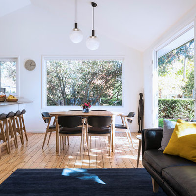 Dining room - small contemporary medium tone wood floor and brown floor dining room idea in Canberra - Queanbeyan with white walls