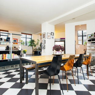 Inspiration for a medium sized industrial dining room in London with white walls, multi-coloured floors and no fireplace.