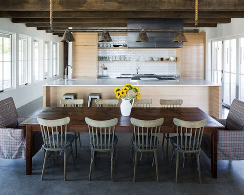 Example Of A Country Concrete Floor And Gray Kitchen Dining Room Combo Design In