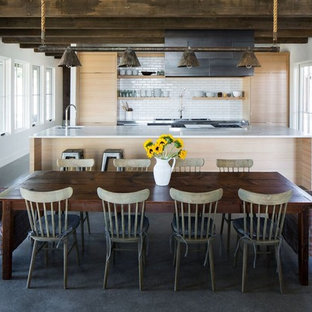Example of a country concrete floor and gray floor kitchen/dining room combo design in Salt Lake City with white walls