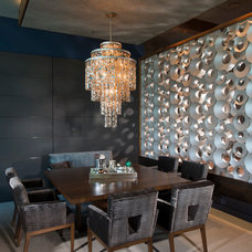 Modern Dining Room by Maggetti Construction Inc.