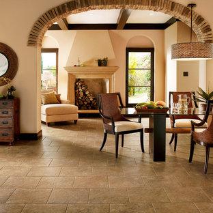 Exemple d'une grande salle à manger ouverte sur le salon éclectique avec un mur beige, un sol en vinyl et une cheminée standard.