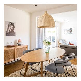 Midcentury open plan dining in Adelaide with white walls, medium hardwood floors and brown floor.