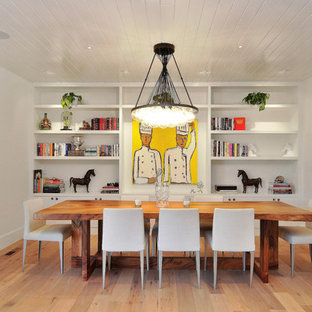 Inspiration for a contemporary medium tone wood floor and brown floor dining room remodel in San Francisco with white walls