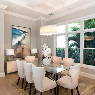 Dining room - transitional light wood floor dining room idea in Miami with beige walls