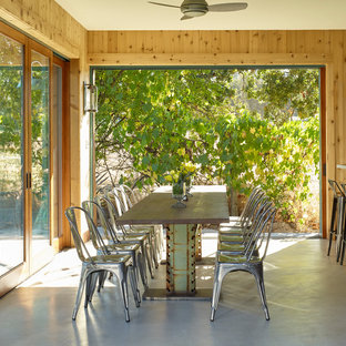 Example of a mountain style concrete floor and gray floor dining room design in San Francisco