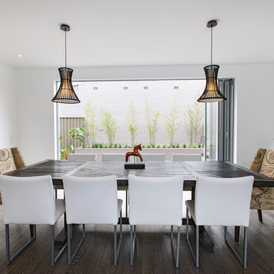 Trendy dining room photo in Sydney with white walls