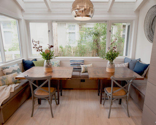 example of a mid sized trendy medium tone wood floor and brown floor great room