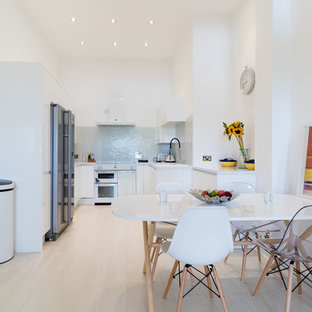 Inspiration for a small contemporary kitchen/dining room in London with white walls, light hardwood flooring and beige floors.