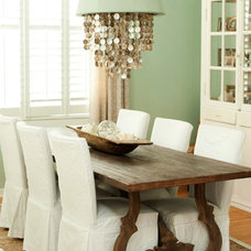 Transitional Dining Room by The Blue Moon Trading Company