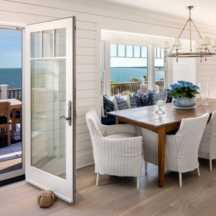 Kitchen/dining room combo - beach style medium tone wood floor kitchen/dining room combo idea in New York with white walls