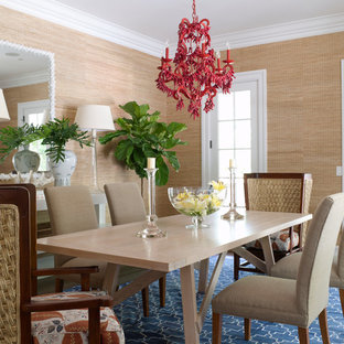 Inspiration for a tropical dining room remodel in New York with beige walls