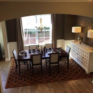 Mid-sized minimalist medium tone wood floor great room photo in Charleston with brown walls