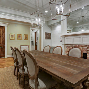 Example Of A Classic Medium Tone Wood Floor And Brown Enclosed Dining Room Design In