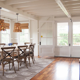 Large coastal medium tone wood floor enclosed dining room photo in Bridgeport with white walls