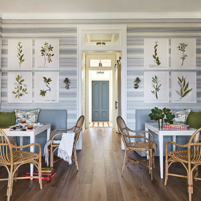 Small beach style dark wood floor dining room photo in Jacksonville with multicolored walls