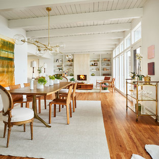 Great room - large contemporary medium tone wood floor and brown floor great room idea in Portland with white walls