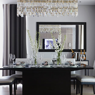 Design ideas for a traditional dining room in London with grey walls, light hardwood flooring and no fireplace.