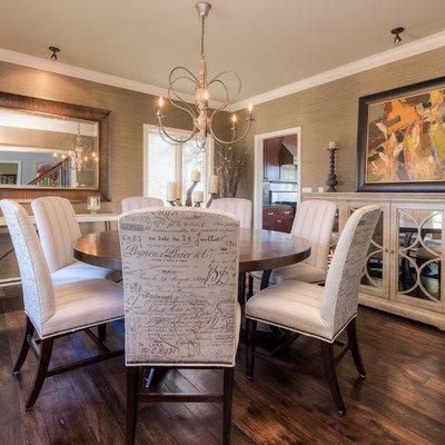 Dining room - transitional dark wood floor dining room idea in Denver