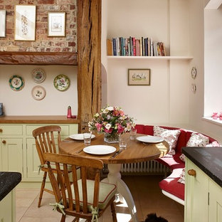 Kitchen/dining room combo - small farmhouse limestone floor kitchen/dining room combo idea in Surrey with beige walls